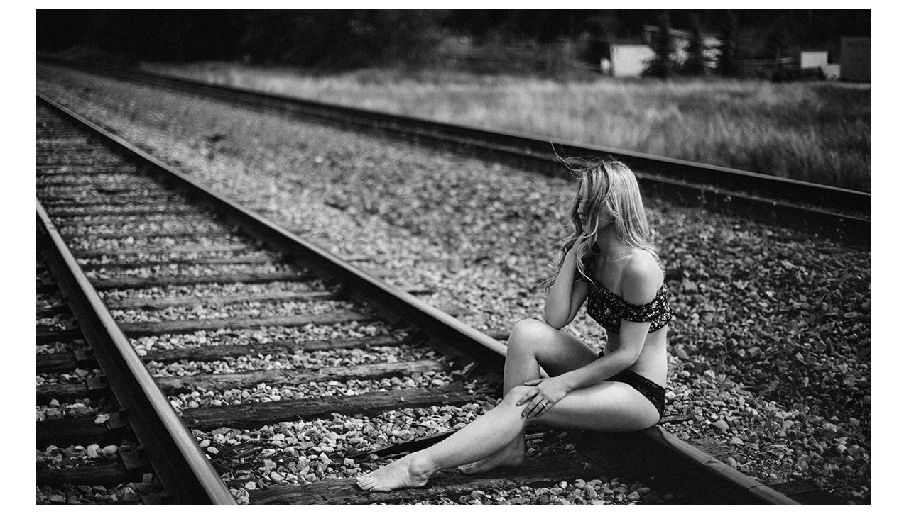 Girl in lingerie sitting on tracks