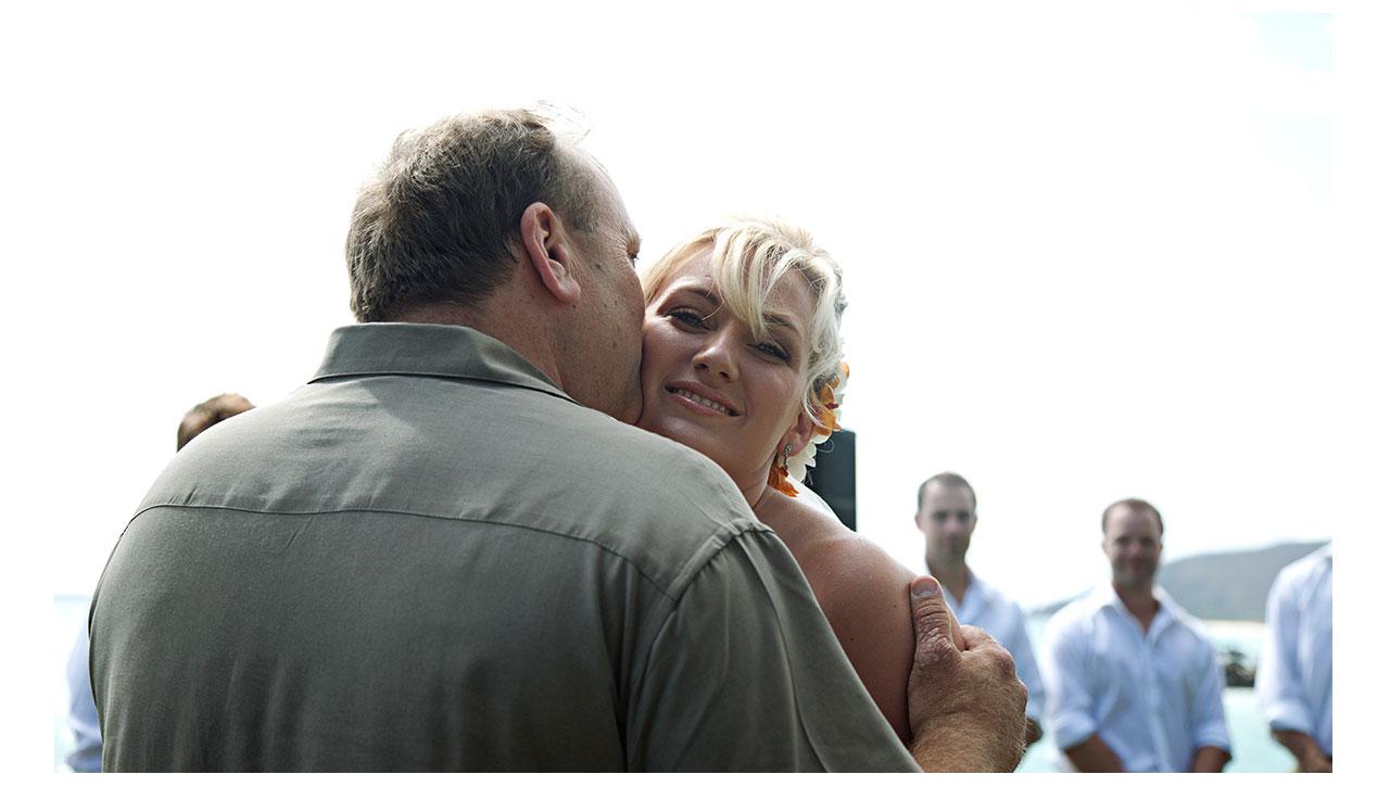 Kisses between bride and dad