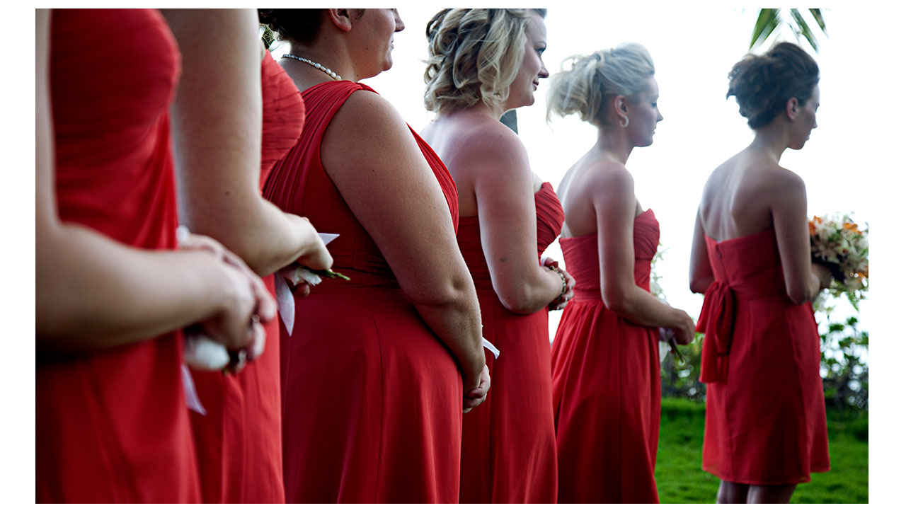 Bridesmaids wearing coral dresses