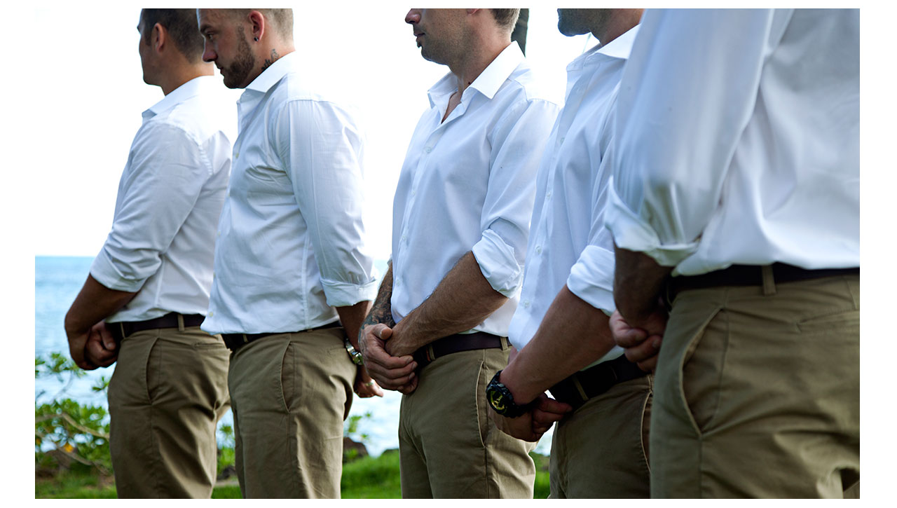 Groomsmen wearing white and taupe