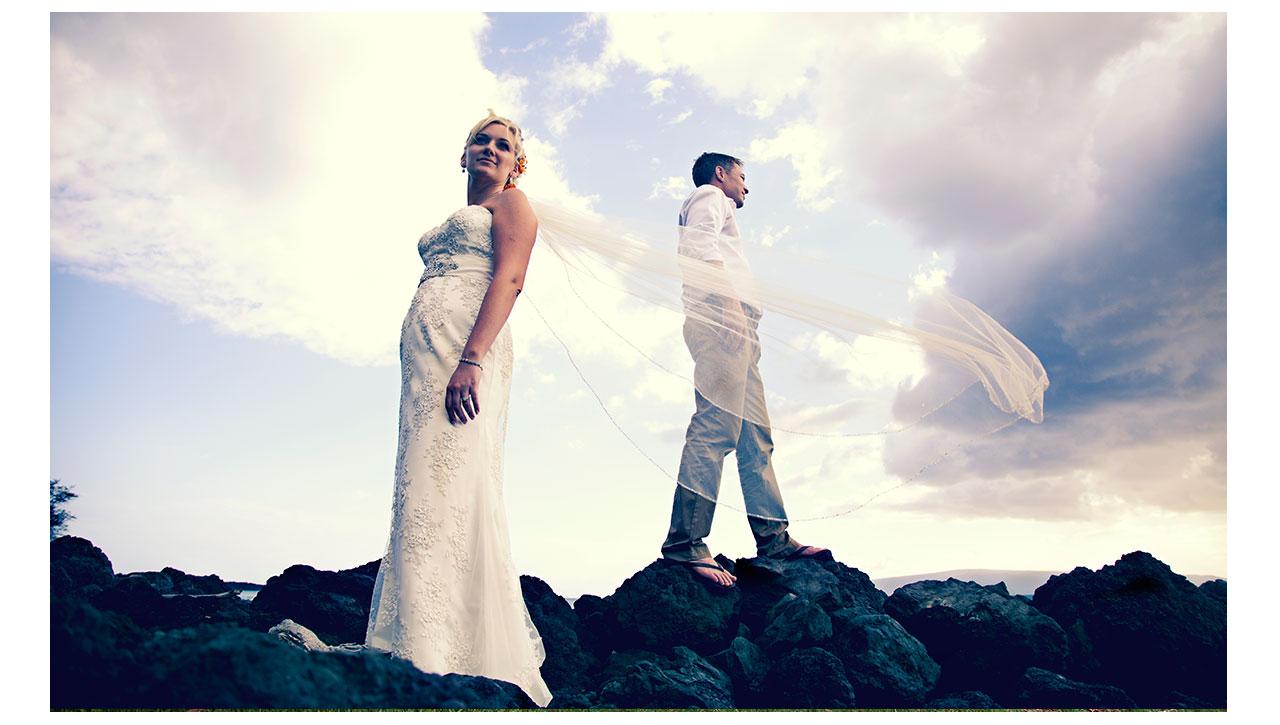 Bride and Groom on lava rocks Maui