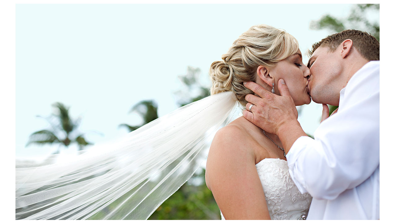 Closeup of couple kissing in Maui